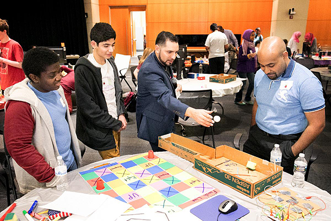Juan Valentin (center) with students during Engineering Week